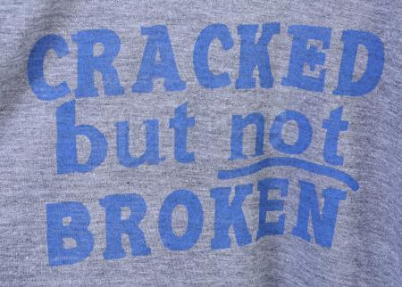"Lot # 217 - S5E03 - ""Basic Intergluteal Numismatical"": Three ""Cracked But Not Broken"" T-Shirts"