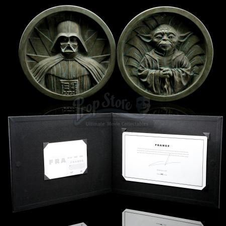 STAR WARS: THE COMPLETE SAGA - George Lucas-Signed Star Wars: Frames Tipped-In Page and Prototype Medallions